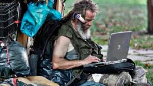 Homeless Man on Computer